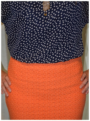 Navy top orange skirt