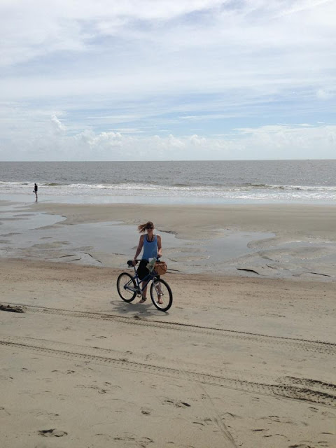 Tybee Island riding bike on beach