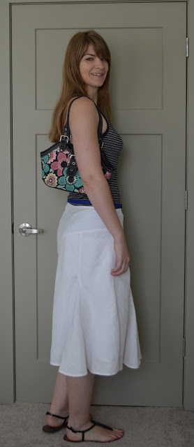 White linen skirt black tank floral purse