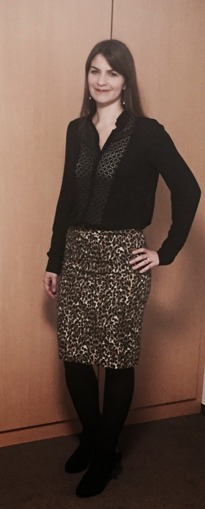 Sheer black blouse leopard print skirt
