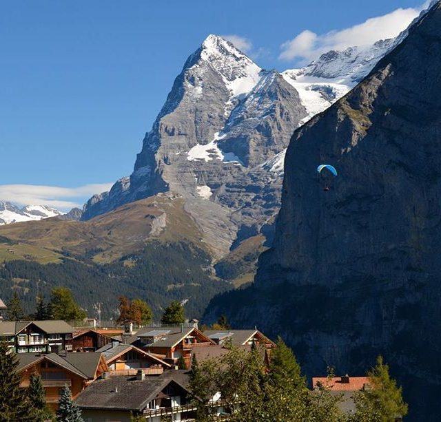 Mrren lunch views  paragliders floating by pretty rooftops andhellip