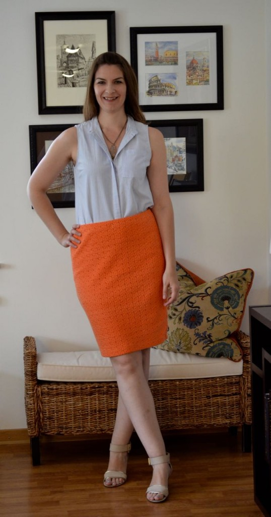 Blue top orange skirt