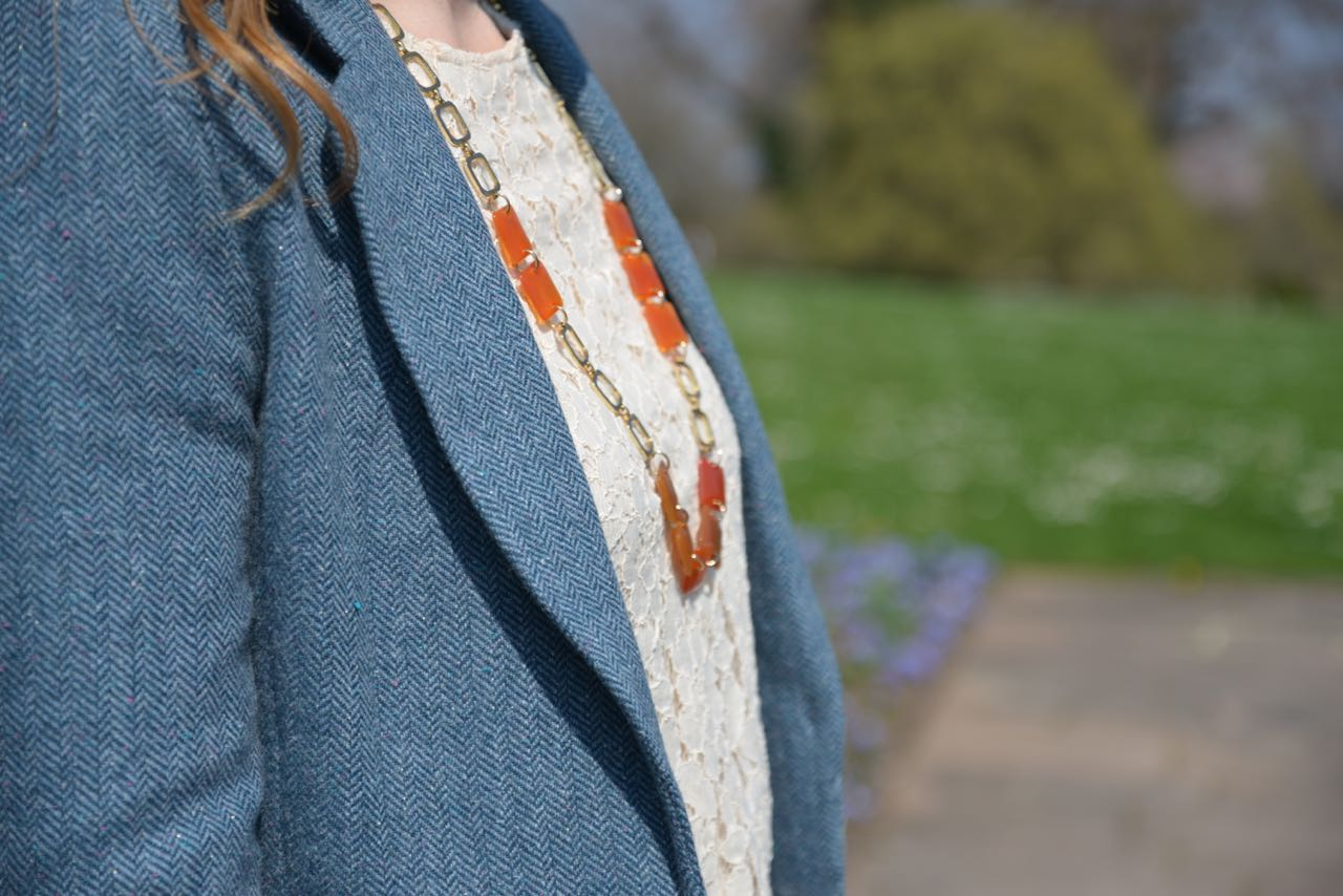 Blue blazer lace top orange necklace